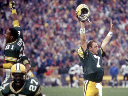 Green Bay Packers quarterback Don Majkowski (7) celebrates the instant-replay call confirming his game-winning touchdown pass to Sterling Sharpe against the Chicago Bears at Lambeau Field on Nov. 5, 1989. The Packers won 14-13.