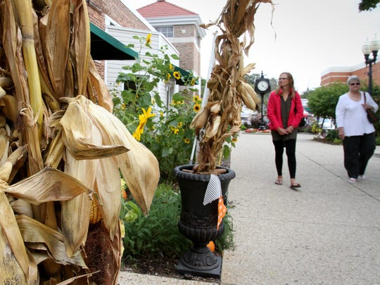 Visitors enjoy Greendale's downtown decorated for the season as they visit Hay Days on Sept. 24.