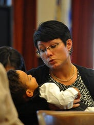 Sam Fritz, 2, sits with his mother Marilyn during the