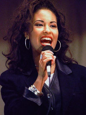 Selena sings at the Cunningham Elementary School in Corpus Christi, Texas, in this Nov. 14, 1994 file photo. The rising Tejano music star was shot dead at 23 by the president of her fan club on March 31, 1995.