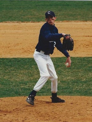 Fox Beyer pitching for Chatham High School in 1997.