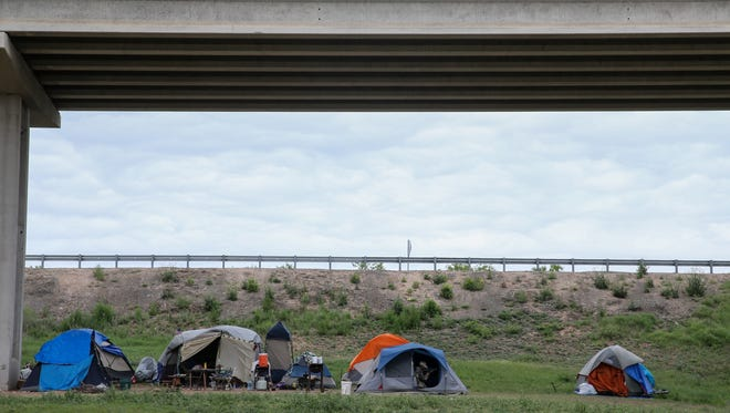 "Homeless people have been living in a ""tent city"" under Loop 306."