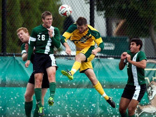 Vermont's Jack Shea (23) heads the ball during the men's soccer game between the Dartmouth Big Green and the Vermont Catamounts last year at Virtue Field.