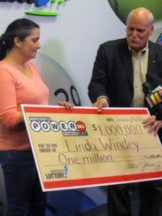 Linda Windey, 41, of Parish, N.Y., receives her $1