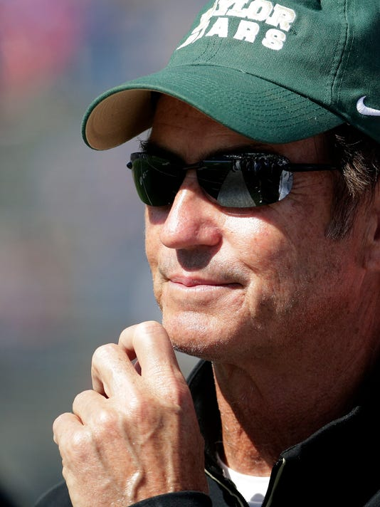 Baylor head coach Art Briles watches during the second half of an NCAA college football game against Kansas Saturday, Oct. 10, 2015, in Lawrence, Kan. Baylor won 66-7. (AP Photo/Charlie Riedel)