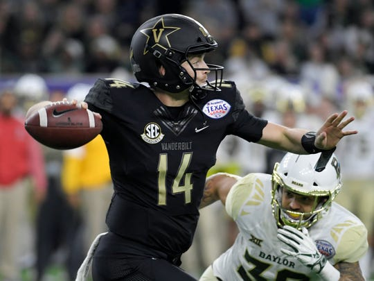 Vanderbilt quarterback Kyle Shurmur prepares to throw as Baylor linebacker Jordan Williams closes in during the Texas Bowl on Thursday. Shurmur finished the game with 286 yards and a TD on 18-for-37 passing.