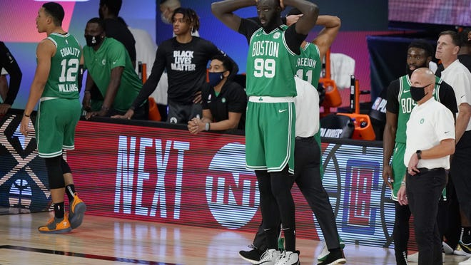 Boston Celtics center Tacko Fall (99) holds his hands on his head after the Celtics fell to the Toronto Raptors at the buzzer in Game 3 of the conference semifinals Thursday in Lake Buena Vista Fla.