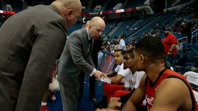 Cincinnati Bearcats head coach Mick Cronin readies his team for the first half of the American Athletic Conference Tournament Championship game between the Southern Methodist Mustangs (1) and the Cincinnati Bearcats (2) at the XL Center in Hartford, Conn., on Sunday, March 12, 2017. At halftime the Mustangs led UC 32-23.