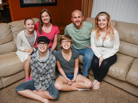 Foster parents Jim and Jackie Feiler with some of their
