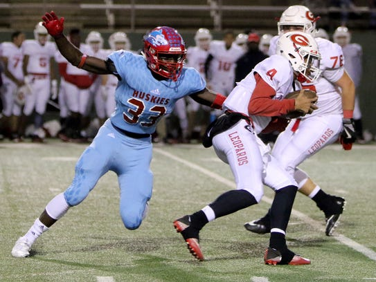 Hirschi's Ezekiel Holmes gets a hand on Gainesville