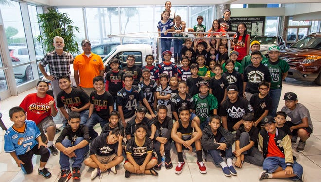 Triple J Ford donated a Ford Ranger pick-up truck to support the Guam National Youth Football Federation's logistical needs for the 2015 season Aug. 5 at the Triple J Enterprises, Inc. Main Headquarters in Upper Tumon.