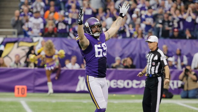 Minnesota Vikings defensive end Jared Allen celebrates after sacking Detroit Lions quarterback Matthew Stafford during the first half of an NFL football game,  Dec. 29, 2013, in Minneapolis.