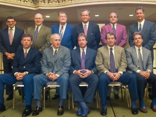 The Big Ten football coaches sit for a group photograph