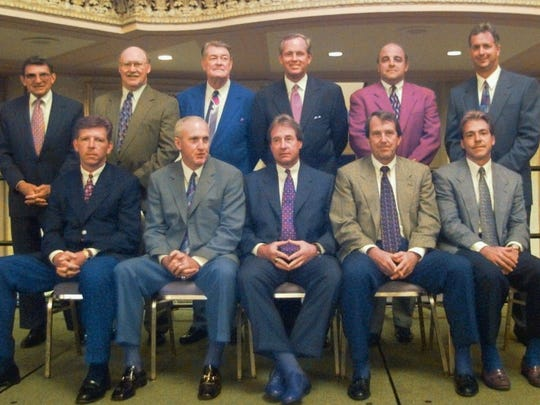 The Big Ten football coaches sit for a group photograph before the 26th Annual Big Ten Kickoff Luncheon in Chicago Wednesday, July 30, 1997. Seated, from left are: Cam Cameron, Indiana; John Cooper, Ohio State; Gary Barnett, Northwestern; Lloyd Carr, Michigan; and Nick Saban, Michigan State. Standing, from left are: Joe Paterno, Penn State; Joe Tiller, Purdue; Hayden Fry, Iowa; Glenn Mason, Minnesota; Barry Alvarez, Wisconsin; and Ron Turner, Illinois.