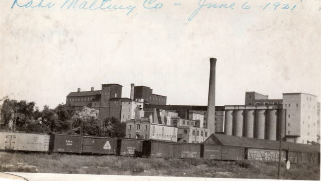 Rahr Malting Co. in Manitowoc from shoreline looking west on June 6, 1921.