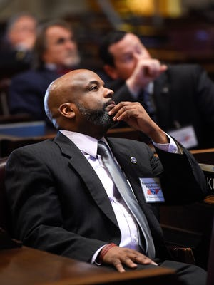 State Rep. Rick Staples, D-Knoxville, watches a video inside the House chamber on Dec. 7, 2016.