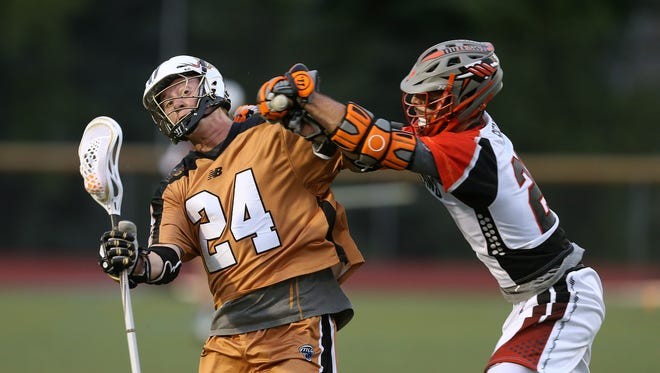 Rattlers Michael Lazore (24) draws a penalty as he is checked in the head by Denver's Jeremy Sieverts.