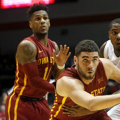 Iowa State Cyclones forward Georges Niang (31), center,