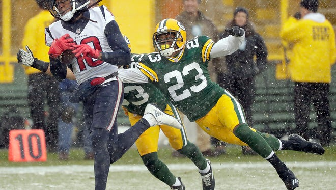 Houston Texans wide receiver DeAndre Hopkins (10) beats Green Bay Packers cornerback Damarious Randall (23) to score a touchdown at Lambeau Field.