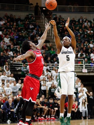 Michigan State guard Cassius Winston (5) takes a shot against Youngstown State during the Spartans' 77-57 win. Winston had eight points and nine assists.