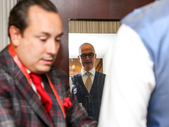 Savile Row master tailor Steven Hitchcock, left, takes