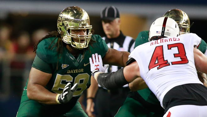 Baylor guard Cyril Richardson (68) blocks on the line of scrimmage during the game against the Texas Tech Red Raiders in 2013.