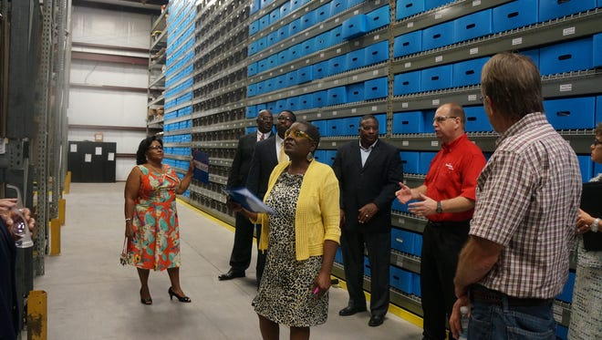 Local officials and guests take a tour Wednesday of Safelite AutoGlass' new warehouse and distribution center that has opened in Midway.