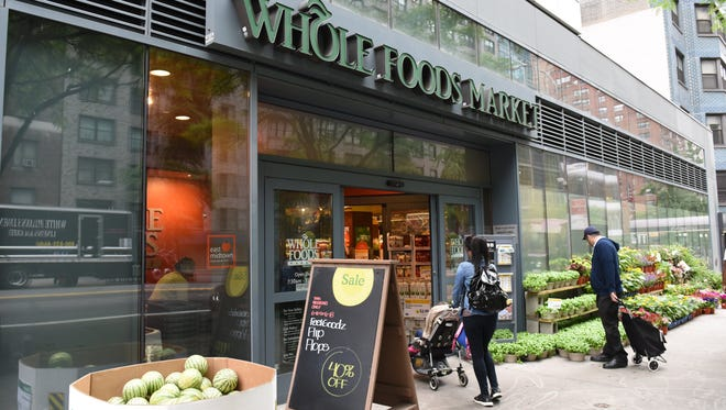 The Whole Foods Market in Midtown New York is seen on June 16, 2017. Amazon shook up the retail sector with the announcement  on June 16, 2017, it would acquire upscale U.S. grocer Whole Foods Market, known for its pricey organic options,  in a deal that underscores the online giant's growing influence in the economy.