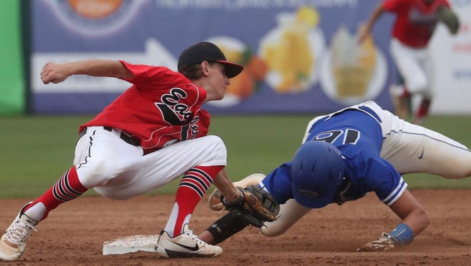 NFC second baseman Tyler Martin tries to lay a tag on Canterbury's Danny Cunningham during Thursday's Class 3A state championship game.