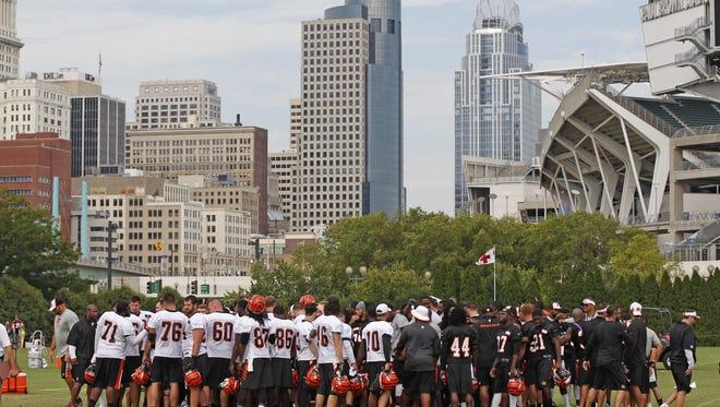 Cincinnati Bengals' players huddle following practice at the Bengals training camp.