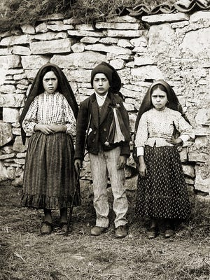 Lucia Santos (left) with her cousins Francisco and Jacinta Marto who reported visits by the Virgin Mary at Fatima, Portugal in 1917.