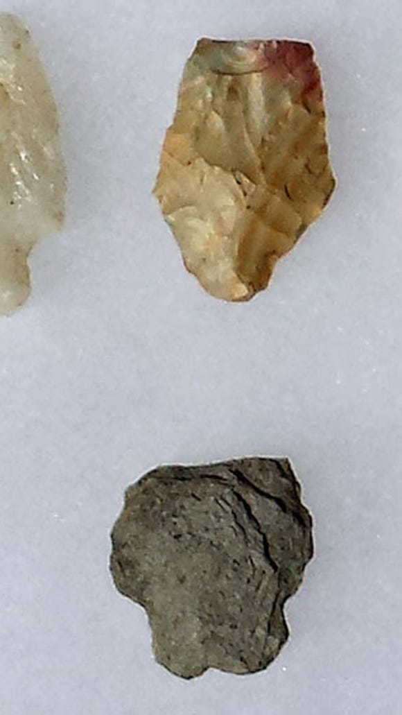 Partial spear points: top left quartz from the Middle Archaic period (4000-5000 B.C.), the middle piece chert from the Ohio Valley of the Late Archiac  period(1800-1000 B.C.) and the quartz (locally sourced) on the right also Late Archiac. The bottom piece is rhyolite from the South Mountain region dating to the Early Archaic period (6000-8000 B.C.).