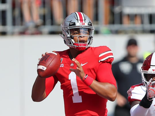 Sep 21, 2019; Columbus, OH, USA; Ohio State Buckeyes quarterback Justin Fields (1) drops to throw as Miami (Oh) Redhawks linebacker Myles Reid (17) rushes during the first quarter at Ohio Stadium. Mandatory Credit: Joe Maiorana-USA TODAY Sports