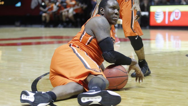 Oregon State forward Jarmal Reid (32) looks for eye contact with the referee after falling to the floor in the second half of an NCAA college basketball game against Utah Sunday, Jan. 17, 2016, in Salt Lake City. Utah won 59-53. (AP Photo/Rick Bowmer)