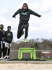 Liberty triple jumper Keyshawn King practices at the
