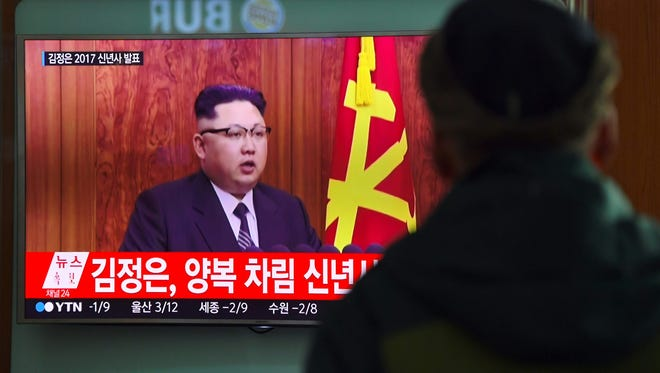"This file photo taken on December 31, 2016 shows a man watching a television news broadcast at a railway station in Seoul showing North Korean leader Kim Jong-Un's New Year's speech. The United States is certain it can defend itself from an attack by North Korea, the Defense Department said on January 3, 2017 after Pyongyang warned it was close to test launching a ballistic missile. ""We remain confident in our ballistic missile defense and in our defense of our allies and our defense of the homeland,"" Pentagon spokesman Peter Cook said at a news briefing."