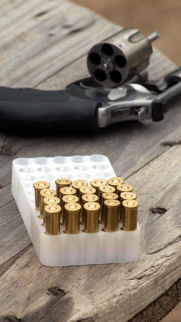 -  -Rounds are ready to be fired during a handgun-qualification shooting session.