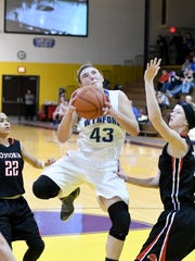Wynford's Gretchen Harris eyes the basket as she moves