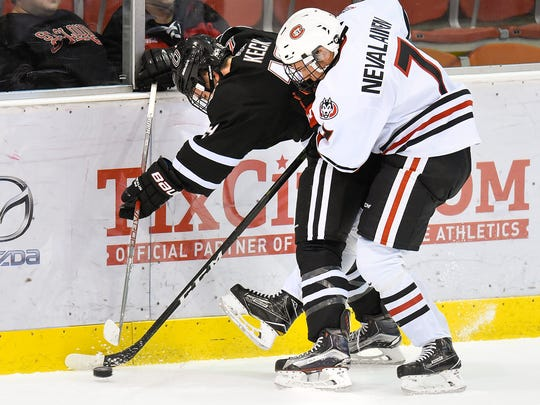 St. Cloud State's Niklas Nevalainen tries to get the