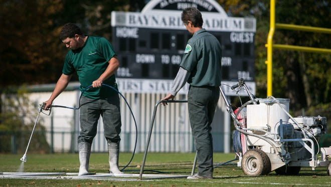 Anthony Veag and Lisa McHugh with Wilmington State Parks paint the field at Baynard Stadium. The city of Wilmington, the State of Delaware and Salesianum School announce they have reached a tentative agreement on a long-tern lease that would revitalize Baynard Stadium.