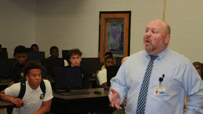 John Whitehead addresses members of the Paramus Catholic football program in the school library Wednesday after being named the Paladins new coach.