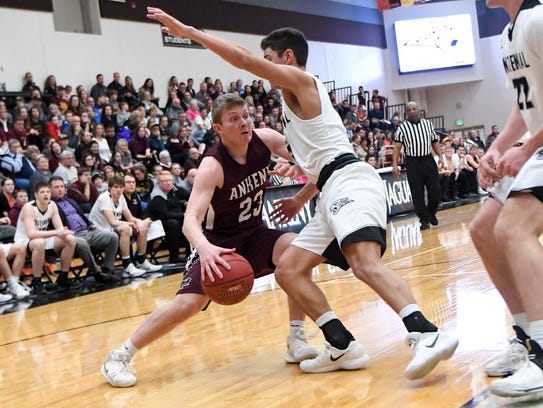 Ankeny's Deaglan Riordan (23) drives to the basket
