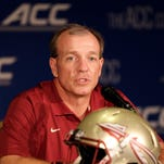 Florida State head coach Jimbo Fisher answers a question during a news conference at the Atlantic Coast Conference Football kickoff in Greensboro, N.C., Monday, July 21, 2014. (AP Photo/Chuck Burton)