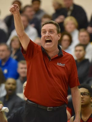 La Salle coach Dan Fleming announced he's retiring on Monday, after 27 years as the Lancers' head coach.