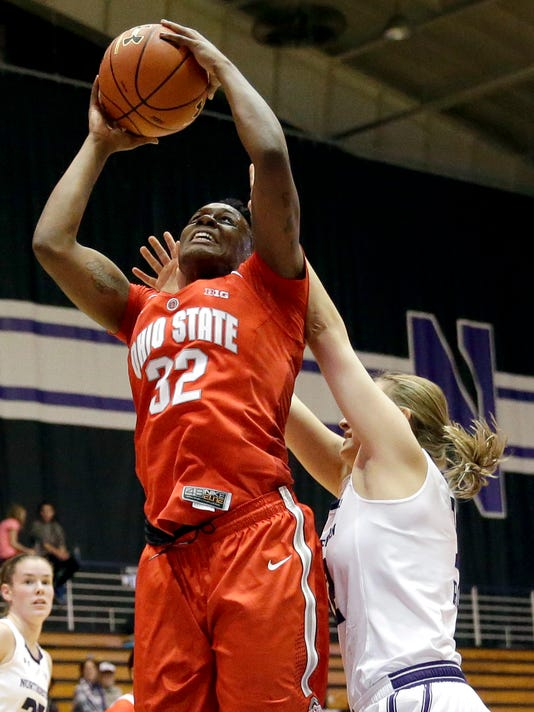 Ohio State forward Shayla Cooper, left, goes up to shoot against Northwestern guard Lydia Rohde during the first half of an NCAA college basketball game Thursday, Jan. 14, 2016, in Evanston, Ill. (AP Photo/Nam Y. Huh)