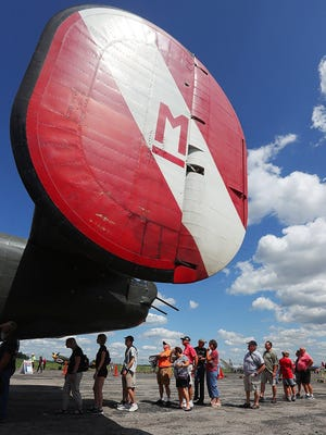 Guests line up to take a tour of the interior of a B-24 Liberator during the Wings of Freedom Tour at the MAPS (Military Aviation Preservation Society) Air Museum in Green in this Aug. 9, 2019 file photo. The museum's Swiss Steak Dinner Fundraiser will be held Friday.