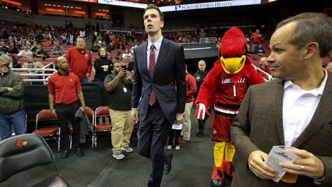 University of Louisville interim head coach David Padgett enters the KFC Yum Center for their exhibition game against Kentucky Wesleyan.   