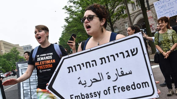 Demonstrators protest outside the Trump International Hotel in Washington, D.C., against the opening of the U.S. embassy in Jerusalem on May 14, 2018.