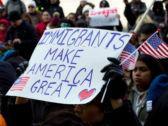 Supporters of immigrants' rights march in downtown