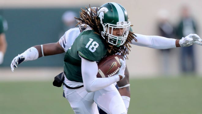 Michigan State Spartans Felton Davis III makes a catch against BYU Cougars Dayan Lake.